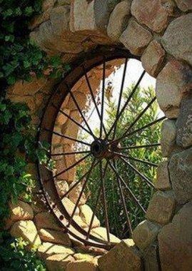old-metal-wagon-wheel-turned-into-patio-art-window